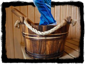 Cage Standing In A Bucket